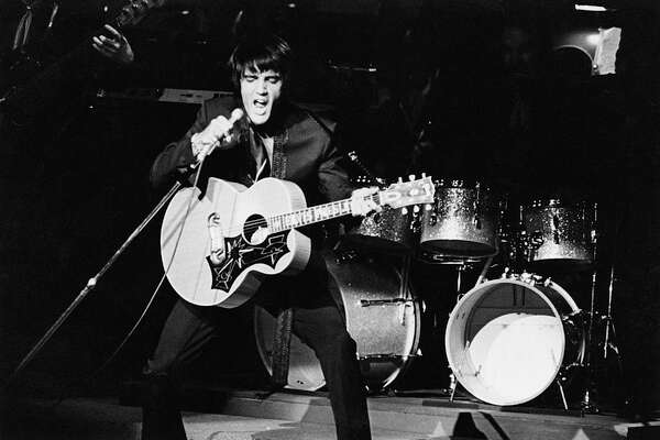 Rock 'n' roll singer and actor Elvis Presley (1935 - 1977) performs at the Las Vegas International Hotel, August 1969. (Photo by Archive Photos/Getty Images)