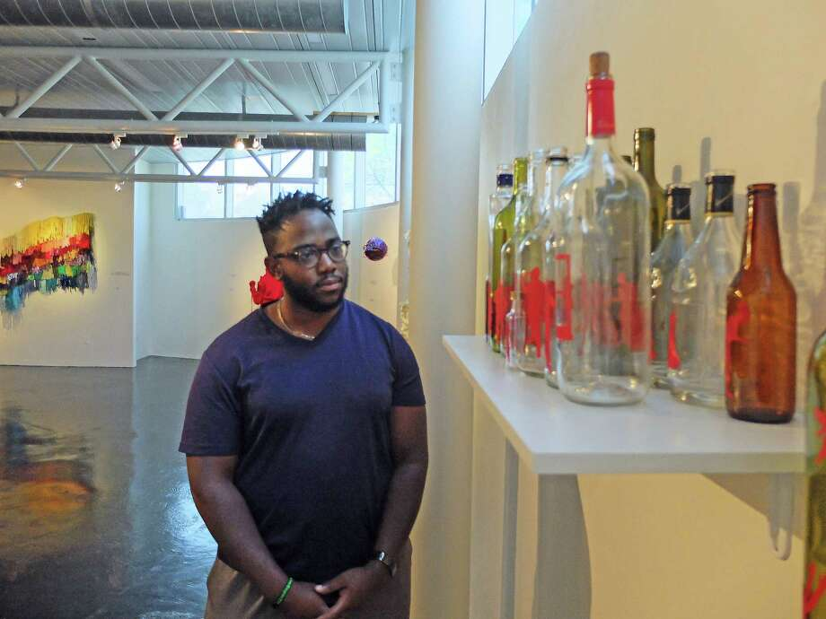 "Dominic Clay, exhibitions manager at the Houston Museum of African American Culture, likes the way a narrative about life plays out in Michael Paul Britto's installation ""A Night with Beau Willie Brown."" Photo: Molly Glentzer"