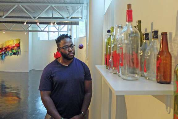 "Dominic Clay, exhibitions manager at the Houston Museum of African American Culture, likes the way a narrative about life plays out in Michael Paul Britto's installation ""A Night with Beau Willie Brown."""