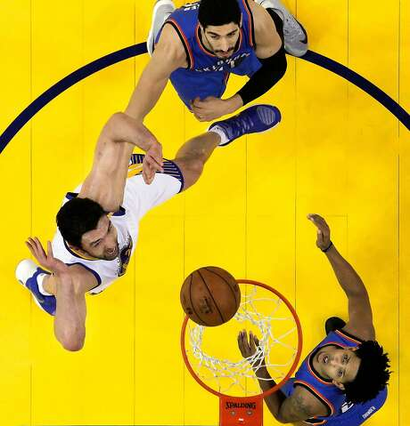 Zaza Pachulia (27) puts up a shot in the first half as the Golden State Warriors played the Oklahoma City Thunder at Oracle Arena in Oakland in January. Photo: Carlos Avila Gonzalez, The Chronicle