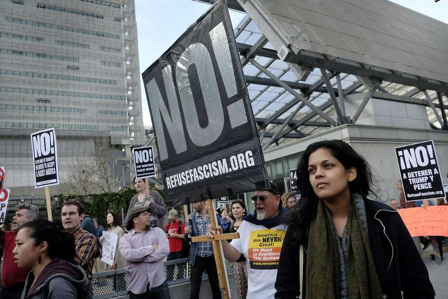 Asian Law Caucus attorney Christina Sinha listens to speakers during a protest against President Trump's new travel ban in front of the Federal Building in San Francisco on Thursday. Photo: Michael Short, Special To The Chronicle