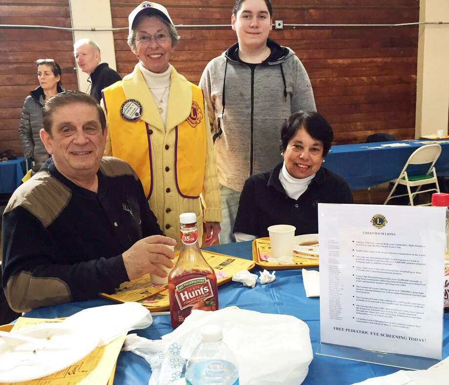 From left, Sam Romeo, Caroline Stafford, Daniel Thiverge and Mary Romeo enjoy the annual Lions Club Pancake Fry in Old Greenwich. Photo: Contributed