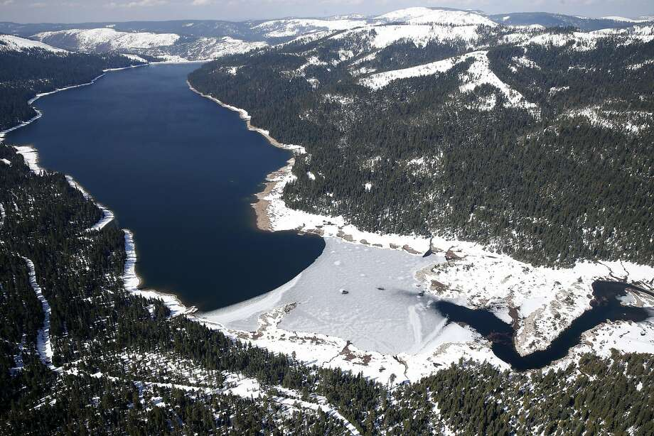 Ice covers the eastern end of the French Meadows Reservoir, part of the watershed managed by the Placer County Water Agency. Energy from hydroelectric plants is expected to rise sharply. Photo: Paul Chinn, The Chronicle