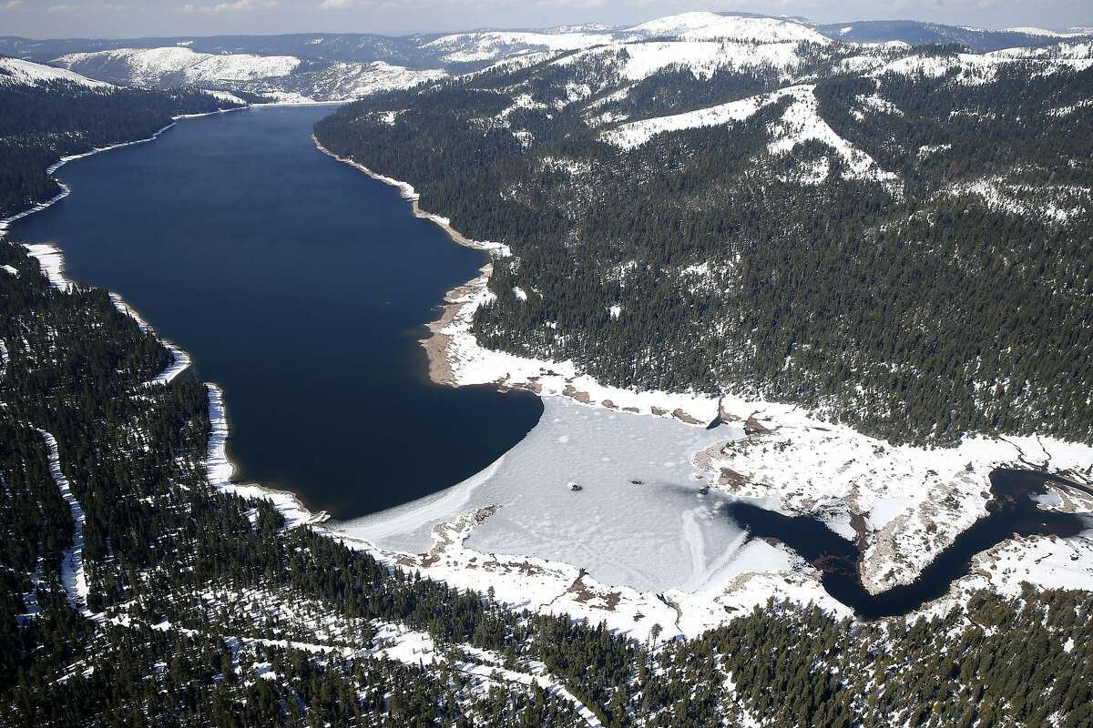 Ice covers the eastern end of the French Meadows Reservoir, which is part of the Middle Fork American River watershed managed by the Placer County Water Agency near Foresthill, Calif. on Wednesday, March 15, 2017. Energy generated from hydroelectric plants is expected to rise dramatically after a season of heavy rain and a deep snowpack.