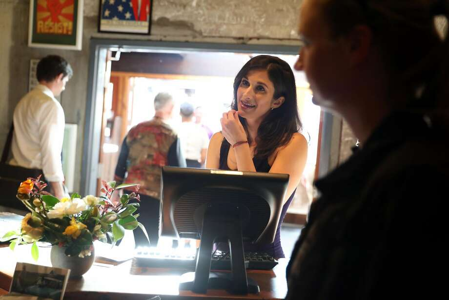 Elizabeth Swartz greets diners at S.F.'s Foreign Cinema, which suffers when patrons fail to follow through on reservations. Photo: Scott Strazzante, The Chronicle
