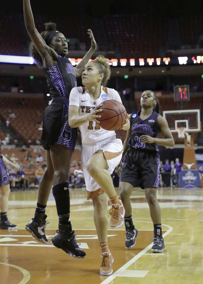 Texas guard Brooke McCarty (11) drives around Central Arkansas forward Raquel Logan (4) during a first-round game in the NCAA women's college basketball tournament, Friday, March 17, 2017, in Austin, Texas. Texas won 78-50. (AP Photo/Eric Gay) Photo: Eric Gay/Associated Press