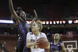 Texas guard Brooke McCarty (11) drives around Central Arkansas forward Raquel Logan (4) during a first-round game in the NCAA women's college basketball tournament, Friday, March 17, 2017, in Austin, Texas. Texas won 78-50. (AP Photo/Eric Gay)