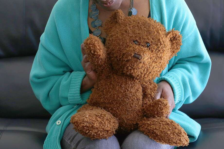 Wanda, who is HIV-positive and says laws against transmission are demoralizing, takes comfort in her teddy bear. Photo: Liz Hafalia, The Chronicle