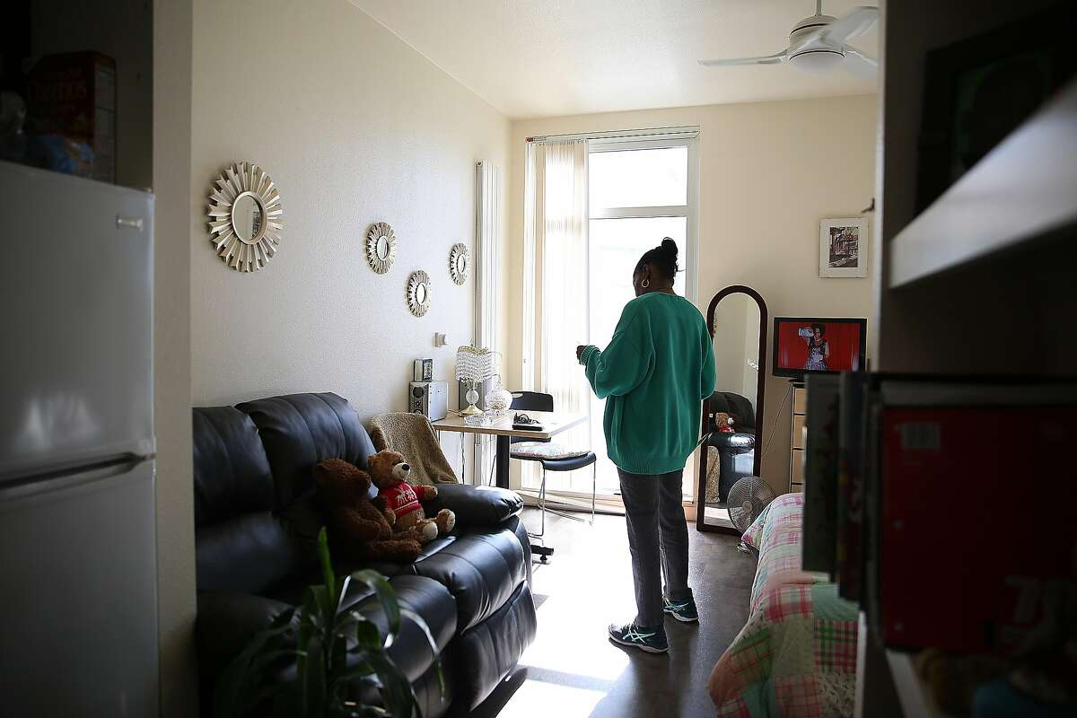 Wanda, who is HIV positive, talks about her past as a prostitute and fears of being prosecuted under existing HIV laws as she looks through her medication at home on Friday, March 17, 2017, in San Francisco, Calif. A legislative proposal to undo California laws that make it a felony to expose someone to HIV underscores the changing nature of the disease.