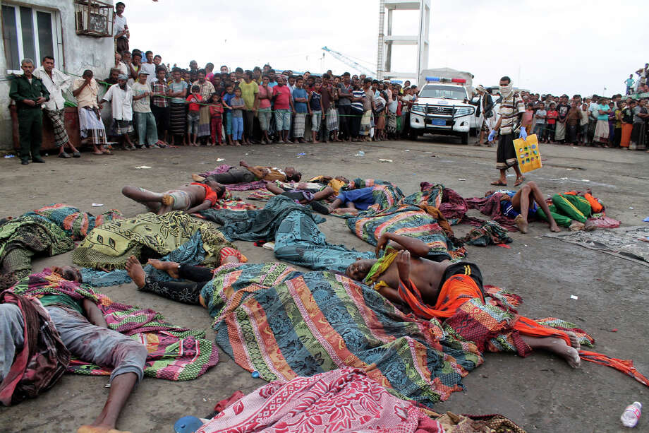 Bodies of Somali migrants, killed in attack by a helicopter while traveling in a boat off the coast of Yemen, lie on the ground at Hodeida, Yemen, Friday, Mar. 17, 2017. A helicopter gunship attacked a boat packed with Somali migrants off the coast of Yemen overnight Thursday, killing at least 31 people, according to a U.N. agency, Yemeni officials and a survivor who witnessed the attack. (AP Photo/Abdel-Karim Muhammed) Photo: Abdel-Karim Muhammed, STR / Copyright 2017 The Associated Press. All rights reserved.