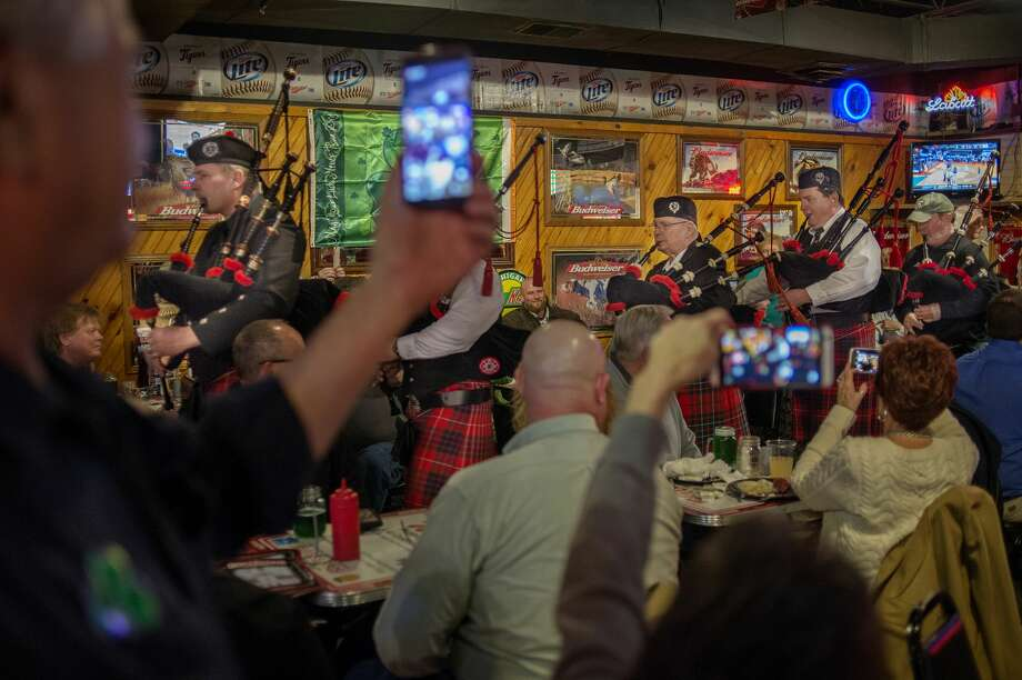 BRITTNEY LOHMILLER | blohmiller@mdn.net Members of the White Pine Pipes and Drums and Highland Dancers play and march around the Boulevard Lounge on St. Patrick's Day. The group performed at St. Brigid Catholic Church, Sanford Bar and Grill, Bennigan's, Diamond Jim's and Big E's as part of a fundraiser for the White Pine Celtic Arts Council. Photo: Brittney Lohmiller/Midland Daily News/Brittney Lohmiller