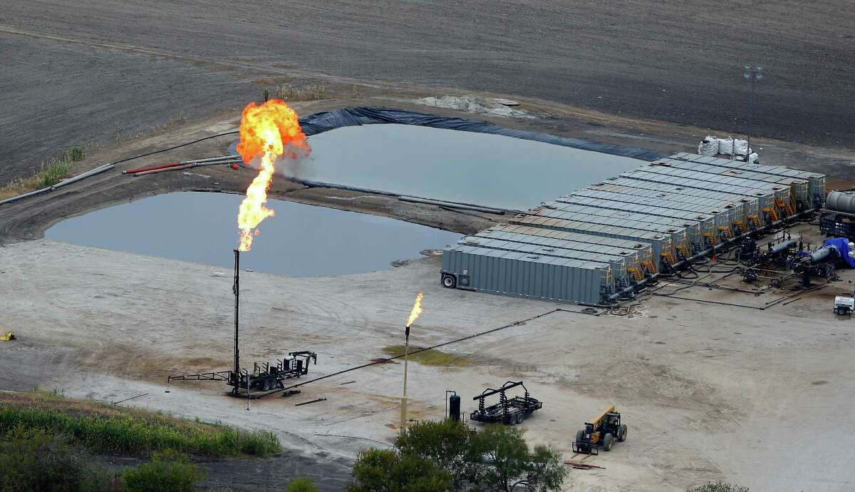 Water retention ponds are seen behind a gas flare, also known as a flare stack, in a Dec. 13, 2013, aerial picture taken in the Eagle Ford Shale region near Karnes City.