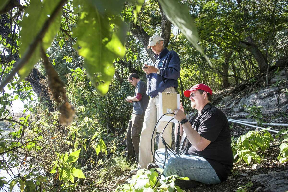 Steve Johnson, research manager for the Edwards Aquifer Authority, center, volunteer Kevin Dorff, right, and field technician for the authority Matt Schwarz search for the source where water flows into Comal Springs as they took water quality samples Dec. 7, 2015, to help the EAA fine-tune its water testing protocol so they can make sure the aquifer stays clean.