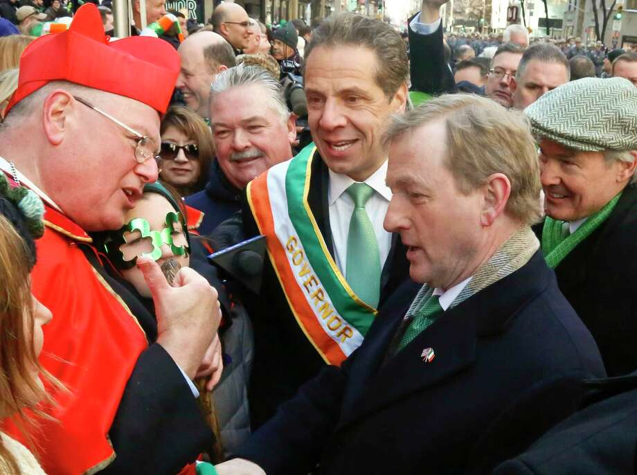 Archbishop of New York Cardinal Timothy Dolan, left, meet with Governor Andrew Cuomo, center, and Prime Minister of Ireland Enda Kenny, second from right, during the St. Patrick's Day Parade, Friday March 17, 2017, at St. Patrick's Cathedral in New York. (AP Photo/Bebeto Matthews) ORG XMIT: NYBM102 Photo: Bebeto Matthews / Copyright 2017 The Associated Press. All rights reserved.