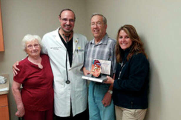 Photo provided Bob Taylor, pictured here with his wife, Gladys, Interventional Cardiologist Maged Rizk, M.D., Ph.D., and Annette Fruge, R.N., B.S.N., structural heart coordinator, was the first patient to undergo the TAVR procedure at MidMichigan Medical Center - Midland.