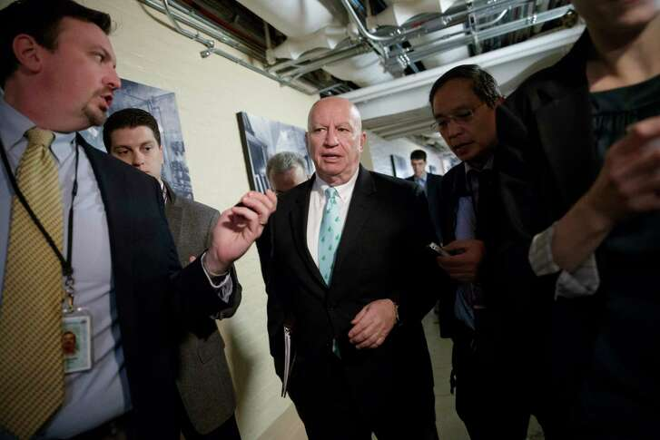"""House Ways and Means Committee Chairman Rep. Kevin Brady, R-Texas, is pursued by reporters as he walks through a basement corridor on Capitol Hill in Washington Friday to meet with Health and Human Services Secretary Tom Price as House Republicans search for unity in advancing the GOP's """"Obamacare"""" replacement bill.  (AP Photo/J. Scott Applewhite)"""
