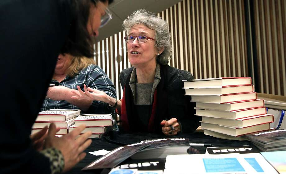 Author Arlie Russell Hochschild signs her books at the Wonkathon held in Oakland to organize anti-Trump groups. Photo: Michael Macor, The Chronicle