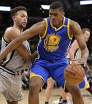 Golden State Warriors forward Kevon Looney (5) drives against San Antonio Spurs forward Kyle Anderson during the first half of an NBA basketball game, Saturday, March 11, 2017, in San Antonio. (AP Photo/Darren Abate)