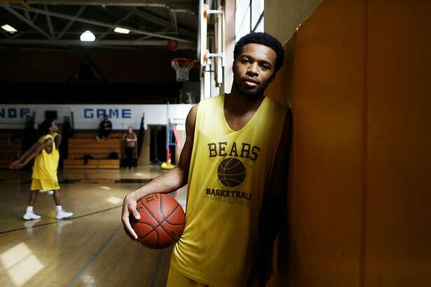Niamey Harris, a senior  at Mission High School, poses for a portrait before practice in his school gym on Friday, March 17, 2017, in San Francisco, Calif.