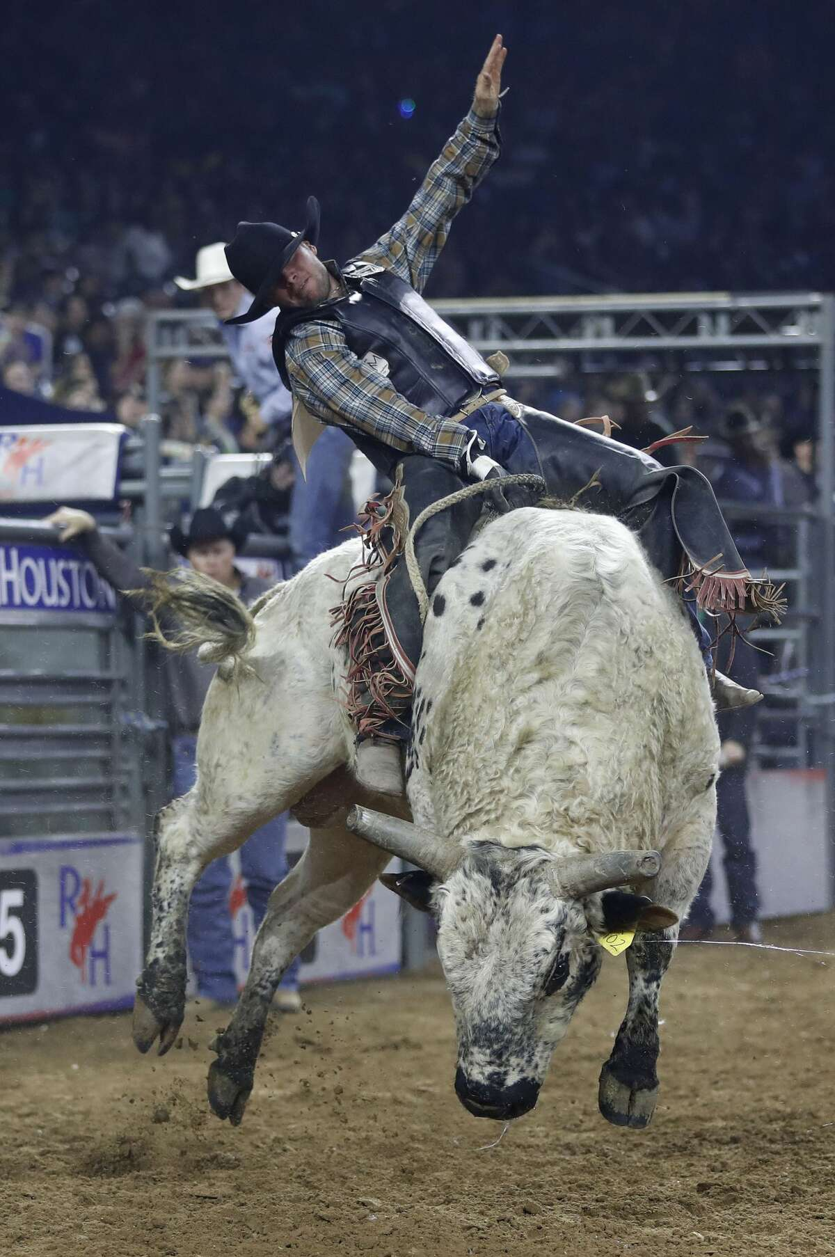 Bayle Worden rides Redneck in the bull riding competition during the Super Series IV, round 2, at NRG Stadium, Friday, March 17, 2017, at the Houston Livestock Show and Rodeo, in Houston. ( Karen Warren / Houston Chronicle )