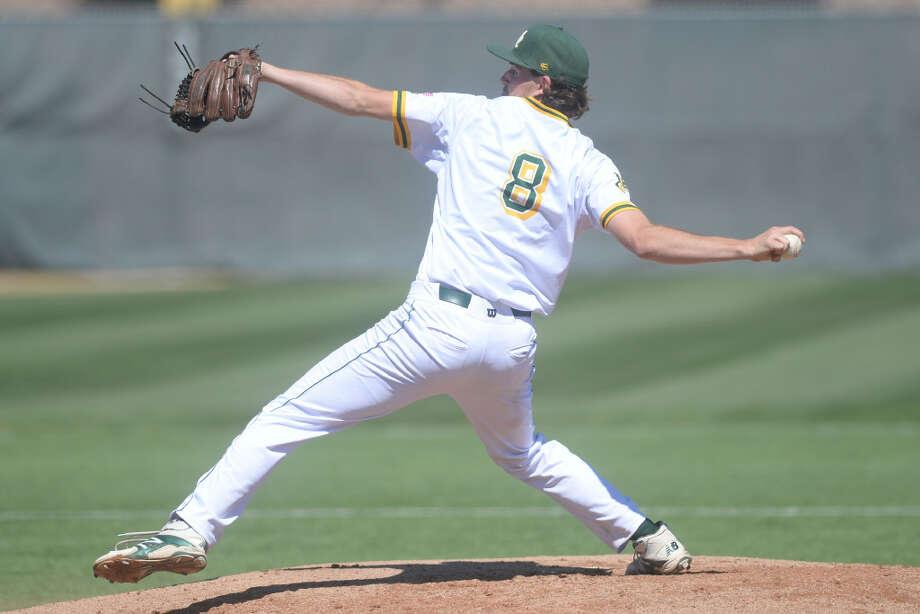 Midland College's Callan Johnson (8) pitches against New Mexico Military Institute on March 17, 2017, at Christensen Stadium. James Durbin/Reporter-Telegram