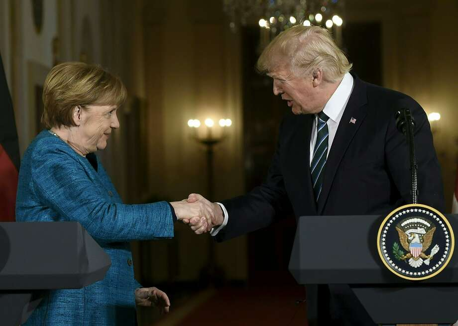 "US President Donald Trump and Germany's Chancellor Angela Merkel shake hands after a press conference in the East Room of the White House March 17, 2017 in Washington, DC. Trump said Friday he and Merkel agreed on the need for a ""peaceful solution"" to the conflict in Ukraine. / AFP PHOTO / SAUL LOEBSAUL LOEB/AFP/Getty Images Photo: SAUL LOEB, AFP/Getty Images"