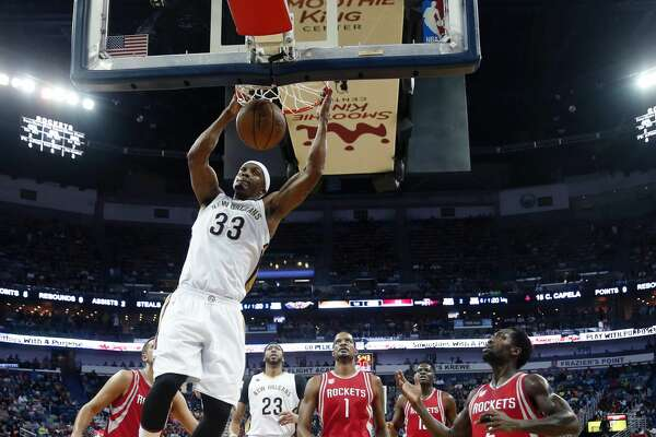 New Orleans Pelicans forward Dante Cunningham (33) dunks in the first half of an NBA basketball game against the Houston Rockets in New Orleans, Friday, March 17, 2017. (AP Photo/Gerald Herbert)
