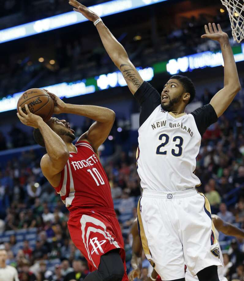 Houston Rockets guard Eric Gordon (10) tries to shoot against New Orleans Pelicans forward Anthony Davis (23) during the first half of an NBA basketball game in New Orleans, Friday, March 17, 2017. (AP Photo/Gerald Herbert) Photo: Gerald Herbert/Associated Press