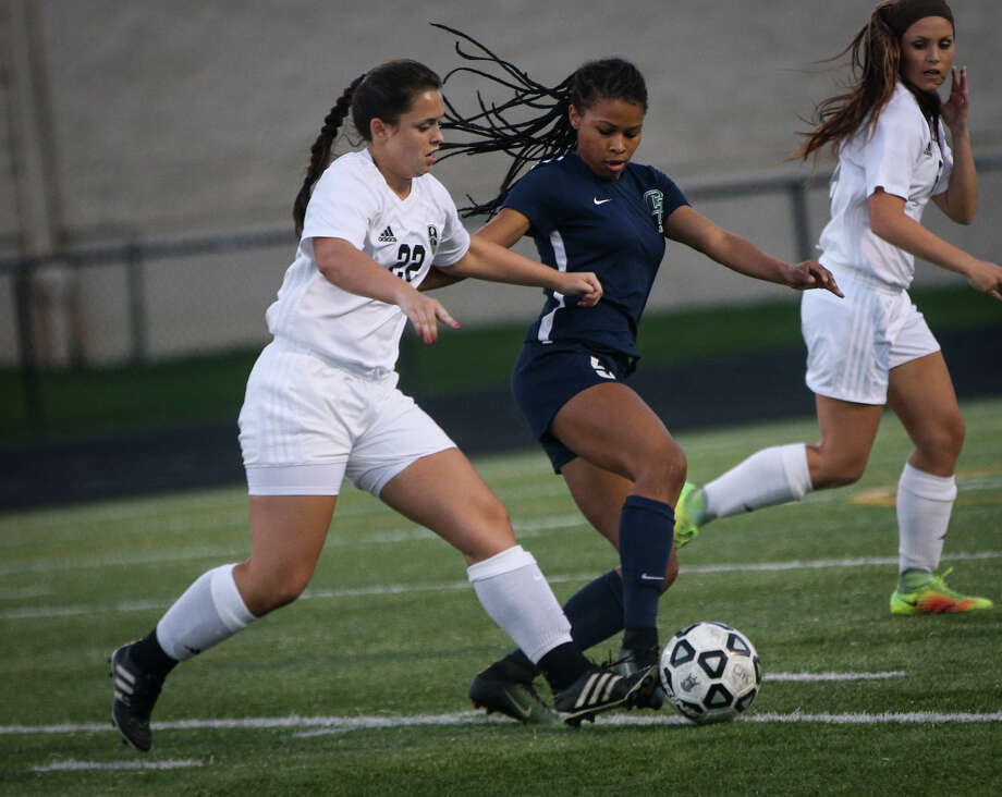 College Park's Reagan Scott (5) and Conroe's Agustina Demagistris (22) battle for the ball during the varsity girls soccer game on Friday, March 17, 2017, at Moorhead Stadium. (Michael Minasi / Chronicle) Photo: Michael Minasi, Staff Photographer / © 2017 Houston Chronicle