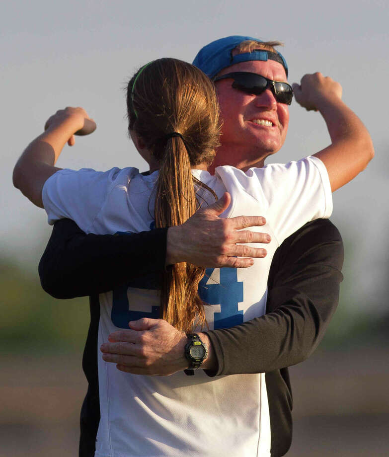 Oak Ridge midfielder Allie Shipp (24) gets a hug from head coach James Collins after her goal during the first period of a District 12-6A high school girls soccer game at War Eagle Stadium on Friday, March 17, 2017, in Conroe. Photo: Jason Fochtman, Staff Photographer / © 2017 Houston Chronicle