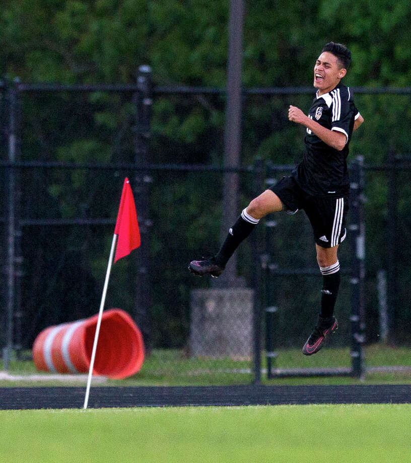 Conroe forward Danny Bonilla (11) leaps up in celebration after scoring a goal during the first period of a District 12-6A high school soccer game at College Park High School Friday, March 17, 2017, in The Woodlands. Conroe tied College Park 1-1 to secure the district's fourth and final playoff spot, and keep the Cavaliers from a share of the district title with The Woodlands. Photo: Jason Fochtman, Staff Photographer / © 2017 Houston Chronicle