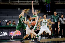 NICK KING | nking@mdn.net Freeland's Lily Beyer, left, and Jenna Gregory, right, pressure Ypsilanti Arbor Prep's Ro'zhane Wells during the first half on Friday at the Breslin Center in East Lansing. Wells' teammate Lauryn Carroll, far right, looks on. Freeland lost the Class B semifinal to Ypsilanti Arbor Prep 54-46.