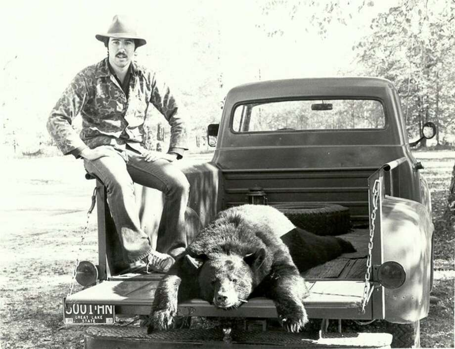 STEVE GRIFFIN | file photo for the Daily News When this black bear was bagged in northern Lower Michigan in the early 1980s, a hunter could get a permit simply be mailing in a post card. Bear numbers and range have expanded since then, as has interest in hunting them, and a drawing and preference point system now determine who gets licenses each year. The application period is to begin May 1 for this year's licenses.