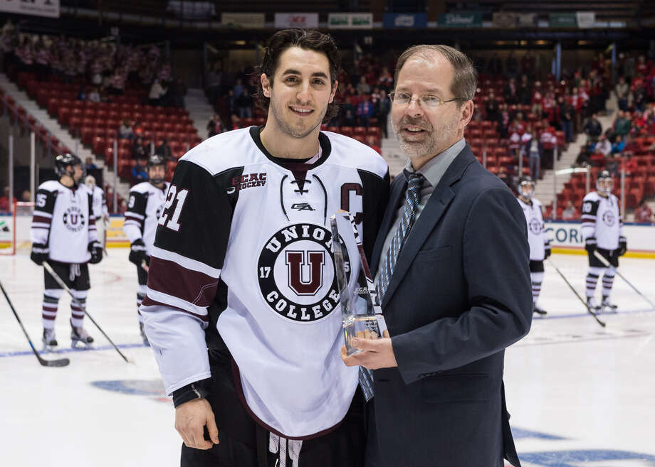 Mike Vecchione of Union receives the ECAC Hockey Player of the Year Award from ECAC commissioner Steve Hagwell prior to Friday's semifinal game against Cornell in Lake Placid. (John DiGiacomo / Placid Times Photography) / John DiGiacomo