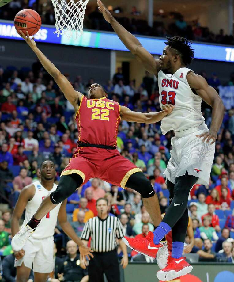 Southern California's De'Anthony Melton (22) goes up for a shot as SMU's Semi Ojeleye (33) defends in the second half of a first-round game in the men's NCAA college basketball tournament in Tulsa, Okla., Friday March 17, 2017. (AP Photo/Tony Gutierrez) ORG XMIT: OKTG213 Photo: Tony Gutierrez / Copyright 2017 The Associated Press. All rights reserved.