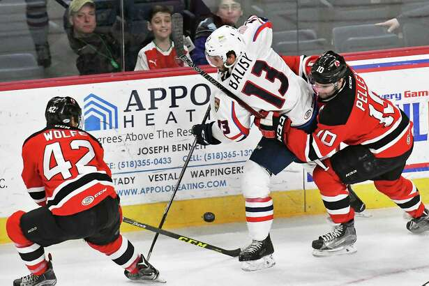 Albany Devils #42 Greg Wolfe, left, and #10 Rod Pelley, right, double team Springfield Thunderbirds' #13 Chase Balisy during Friday's game at the Times Union Center March 17, 2017 in Albany, NY.  (John Carl D'Annibale / Times Union)