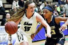 Shenendehowa's Megan Gillooley (15) moves the ball against Baldwin's Nadia Elcock (23) in second half of the New York State Public High School Athletic Association girls' Class AA semifinal basketball game on Friday, March 17, 2017, in Troy, N.Y.  Baldwin won 60-46. (Hans Pennink / Special to the Times Union) ORG XMIT: HP104