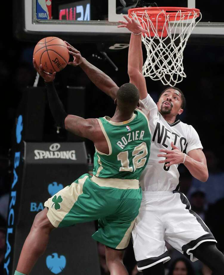 Boston Celtics guard Terry Rozier (12) goes up for a shot against Brooklyn Nets guard Spencer Dinwiddie (8) during the second quarter of an NBA basketball game, Friday, March 17, 2017, in New York. (AP Photo/Julie Jacobson) ORG XMIT: NYJJ104 Photo: Julie Jacobson / Copyright 2017 The Associated Press. All rights reserved.