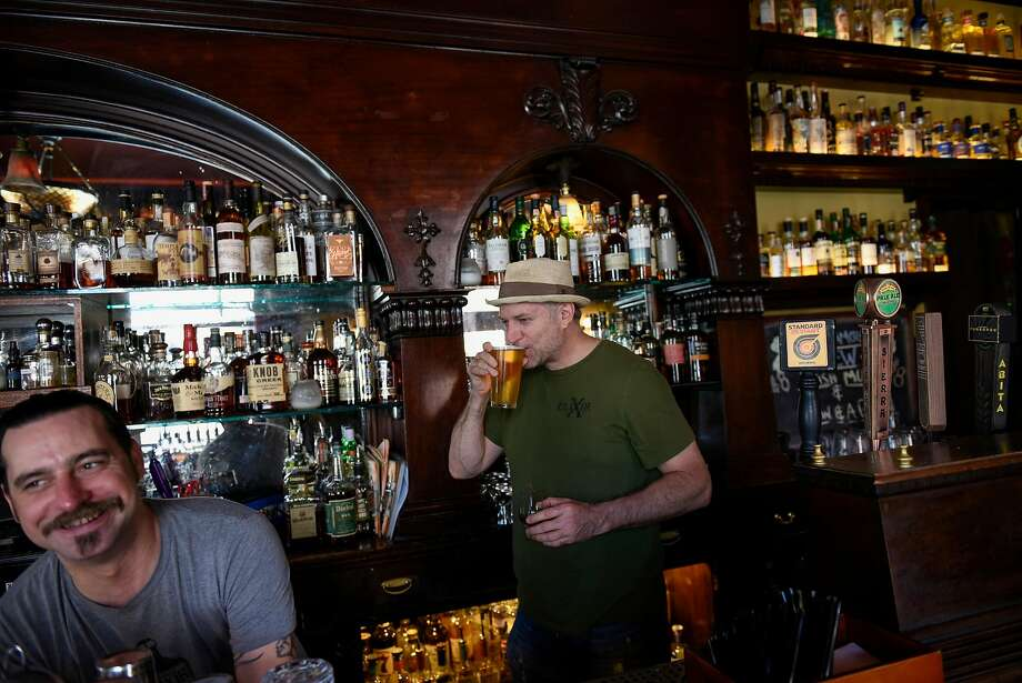 Owner H. Joseph Ehrmann sips a beer behind the bar alongside manager Shea Shawn son at Elixir, S.F.'s second-oldest saloon, at 16th and Guerrero streets. Photo: Michael Short, Special To The Chronicle