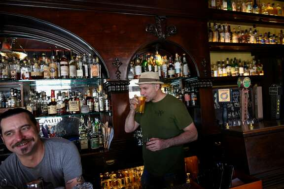 Owner H. Joseph Ehermann sips a beer behind the bar with bar manager Shea Shawnson at Elixir, the second oldest saloon in San Francisco, CA, on Friday March 17, 2017.