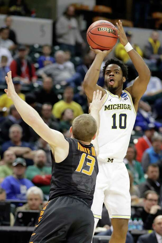 INDIANAPOLIS, IN - MARCH 17:  Derrick Walton Jr. #10 of the Michigan Wolverines shoots the ball against Phil Forte III #13 of the Oklahoma State Cowboys during the first round of the 2017 NCAA Men's Basketball Tournament at Bankers Life Fieldhouse on March 17, 2017 in Indianapolis, Indiana.  (Photo by Andy Lyons/Getty Images) ORG XMIT: 686516171 Photo: Andy Lyons / 2017 Getty Images