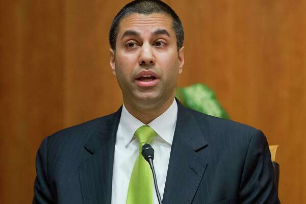 "FILE - In this Thursday, Feb. 26, 2015, file photo, Federal Communication Commission Commissioner Ajit Pai speaks during an open hearing and vote on ""Net Neutrality"" in Washington. Trumpism is slowly taking hold on your phone and computer, as the FCC starts rolling back Obama-era measures, known as ""net neutrality"" rules, which were designed to keep phone and cable giants from favoring their own internet services and apps. Pai, President Donald Trump's hand-picked FCC chief, wants to cut regulations that he believes are holding back faster, cheaper internet. (AP Photo/Pablo Martinez Monsivais, File)"