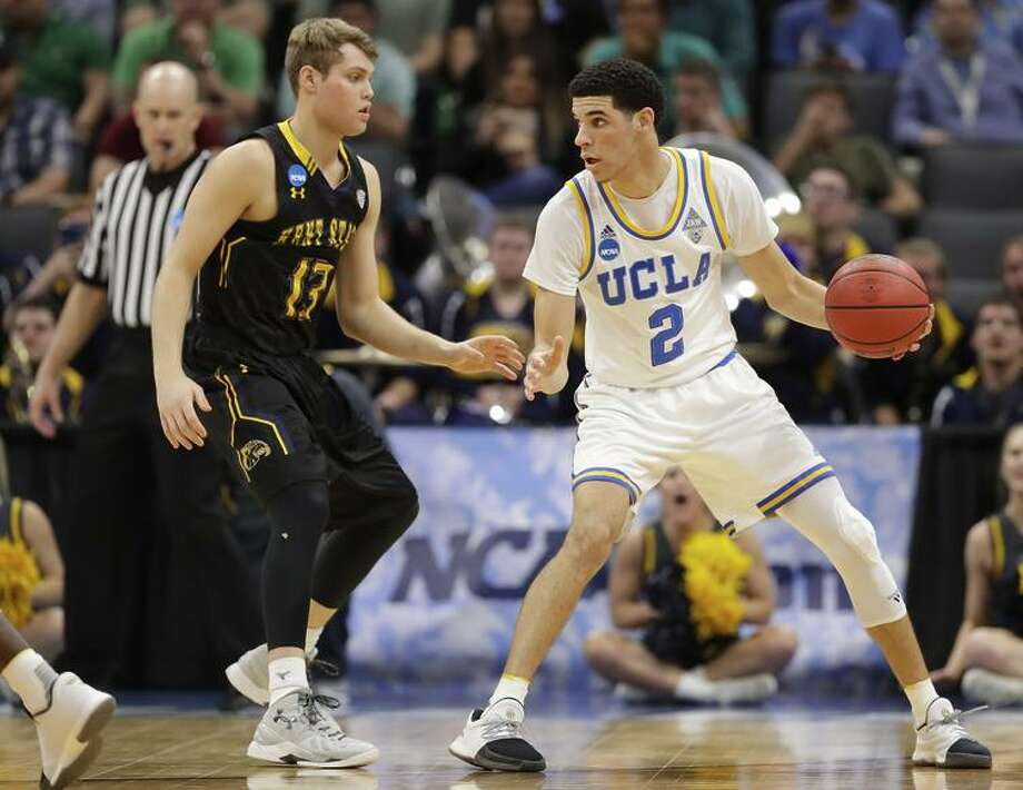 UCLA's Lonzo Ball squares up against Kent State's Jon Fleming in Sacramento. Photo: Jamie Squire / Getty Images / 2017 Getty Images