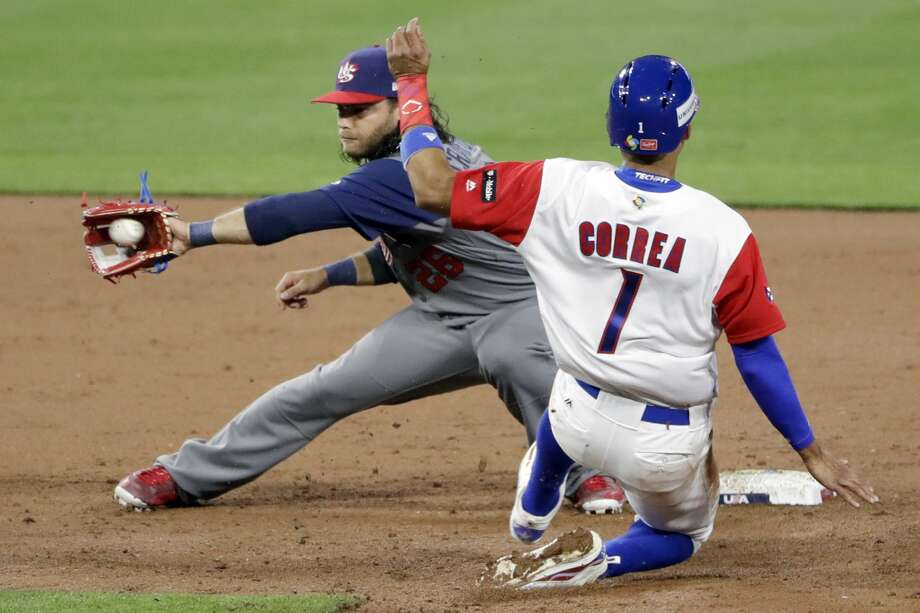 Puerto Rico's Carlos Correa (1) steals second base as U.S. infielder Brandon Crawford is late with the tag during the third inning of a second-round World Baseball Classic baseball game Friday, March 17, 2017, in San Diego. (AP Photo/Gregory Bull) Photo: Gregory Bull/Associated Press