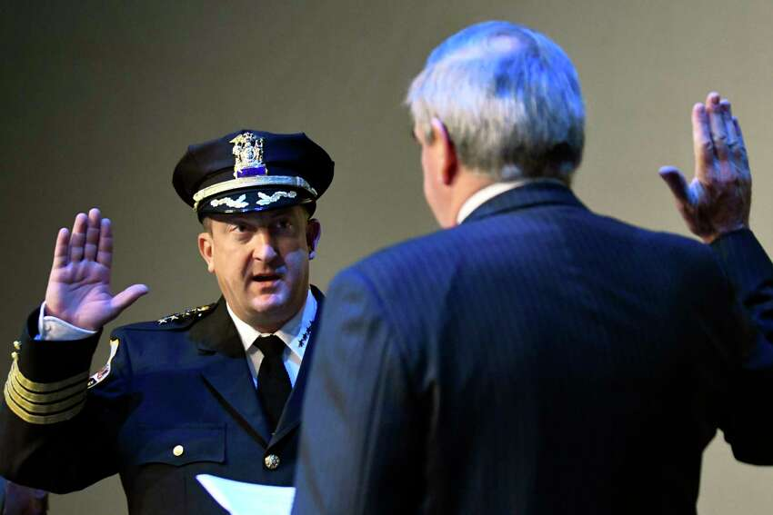 Police Chief Eric Clifford, left, takes the oath of office from Mayor Gary McCarthy during a ceremony on Tuesday, Sept. 13, 2016, at Proctors Theatre in Schenectady, N.Y. (Cindy Schultz / Times Union archive)