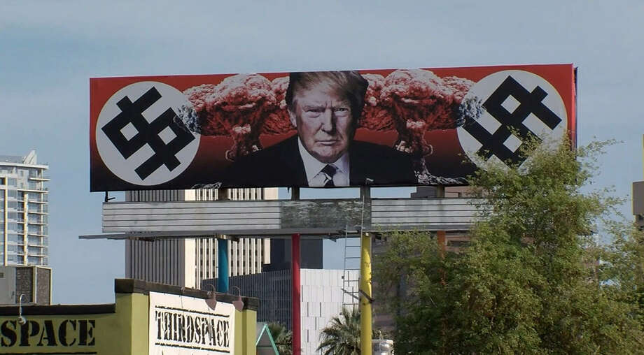 An online petition seeks to have the city of Phoeniz, Ariz., remove a billboard depicting Donald Trump with Nazi symbols, a Russian flag lapel pin and mushroom clouds. City officials say they can't do anything about the sign.>>>Scroll through the gallery to see some of the most colorful, opinionated protest signs concerning Donald Trump Photo: Facebook
