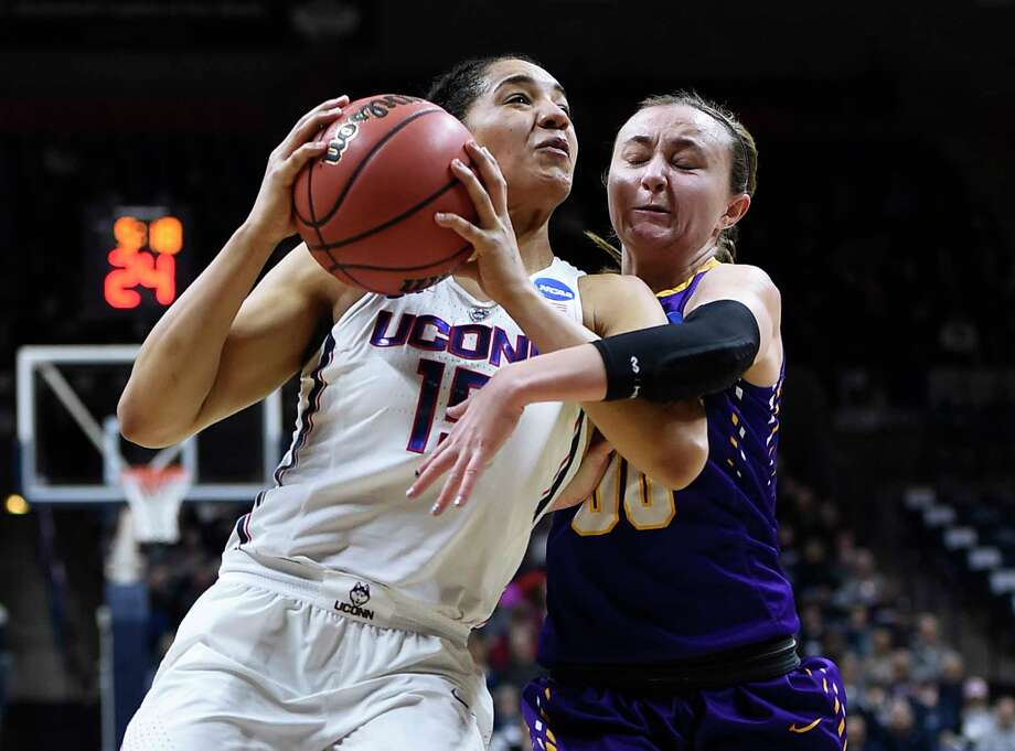Albany's Mackenzie Trpcic, right, fouls Connecticut's Gabby Williams, left, during the first half of a first round round of a women's college basketball game in the NCAA Tournament, Saturday, March 18, 2017, in Storrs, Conn. (AP Photo/Jessica Hill) ORG XMIT: CTJH104 Photo: Jessica Hill / AP2017