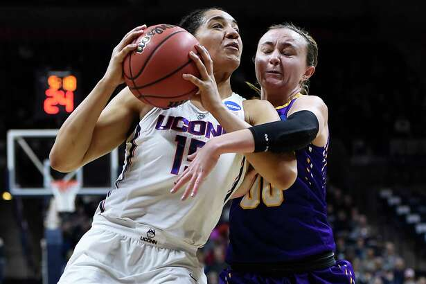 Albany's Mackenzie Trpcic, right, fouls Connecticut's Gabby Williams, left, during the first half of a first round round of a women's college basketball game in the NCAA Tournament, Saturday, March 18, 2017, in Storrs, Conn. (AP Photo/Jessica Hill) ORG XMIT: CTJH104