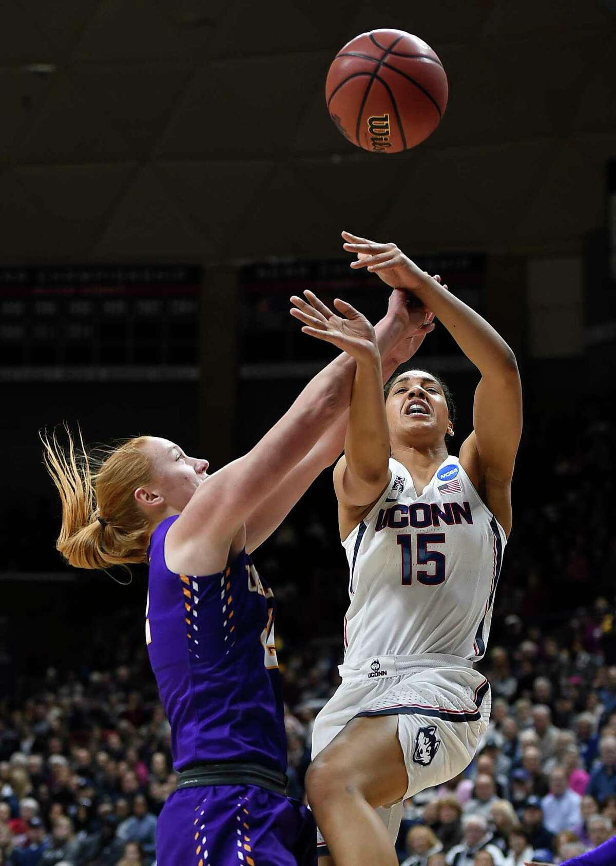 Albany's Heather Forster, left, fouls Connecticut's Gabby Williams, right, during the first half of a first round round of a women's college basketball game in the NCAA Tournament, Saturday, March 18, 2017, in Storrs, Conn. (AP Photo/Jessica Hill) ORG XMIT: CTJH101
