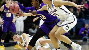 Albany's Imani Tate, left, and Connecticut's Gabby Williams chase down a loose ball during the first half of a first round round of a women's college basketball game in the NCAA Tournament, Saturday, March 18, 2017, in Storrs, Conn. (AP Photo/Jessica Hill) ORG XMIT: CTJH102